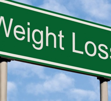 Road sign reading weight loss